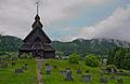 Eidsborg stavkirke med kirkegården.jpg