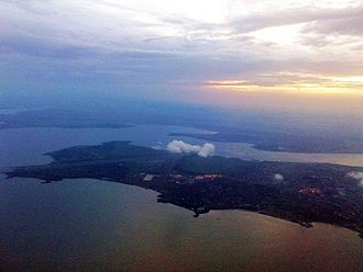 Operation Entebbe - Aerial photo of the city of Entebbe and the Entebbe International Airport at sunset