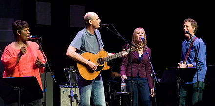 Thomas appearing with James Taylor and others in 2008 Etown james and irma.jpg