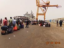 Evacuees queue up for boarding INS Tarkash (01).jpg