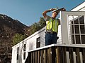FEMA - 33794 - A FEMA contractor works to install a mobile home in California.jpg