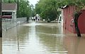FEMA - 37226 - Family walks home through flood waters after Dolly.jpg