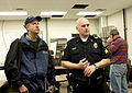FEMA - 40336 - FEMA External Affairs Officer Ed Conley speaks with a Fargo police officer.jpg