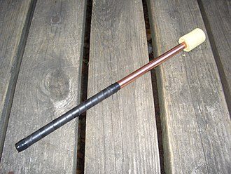 An unlit torch as used for fire breathing. Firebreathingtorch.JPG