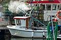 Fisherman cleaning lobster traps in Norra Grundsund 2.jpg