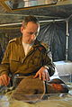 Flickr - Israel Defense Forces - Doctor Abergel Checks on Newborn Haitian.jpg
