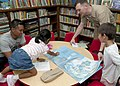 Flickr - Official U.S. Navy Imagery - A Sailor talks to children during story time at Naval Base Guam..jpg