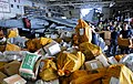 Flickr - Official U.S. Navy Imagery - Sailors and Marines sort mail aboard USS Peleliu..jpg