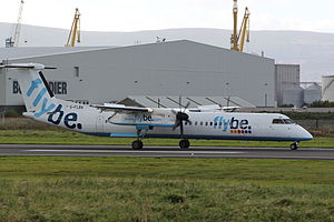 George Best Belfast City Airport - Flybe Bombardier Q400 on the runway at Belfast City Airport