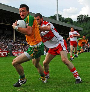 Francis McEldowney - McEldowney (right) tackling Donegal's David Walsh in the 2008 Ulster Championship