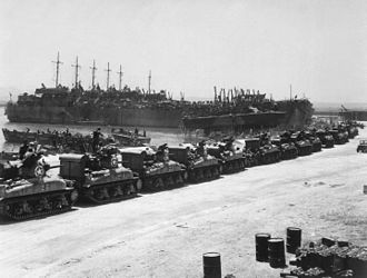 82nd Armored Reconnaissance Battalion - Waiting to load tanks and 82nd M8s in La Pècherie French base in French Tunisia.
