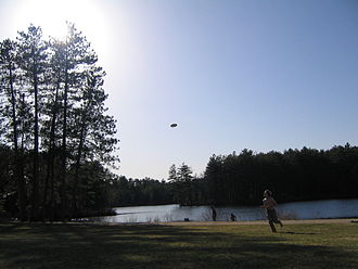 St. Paul's School (Concord, New Hampshire) - Students throw a disc around on the Chapel lawn on a warm spring day.