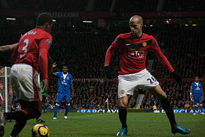 Patrice Evra - Evra (left) passing the ball to Gabriel Obertan in a match against Everton in the 2009–10 season