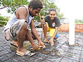 Gail Waki (right) teaches tiling at the Vanuatu Institute of Technology in Port Vila, Vanuatu (10697325496).jpg