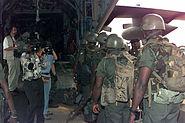 Ghanian ECOMOG troops embarking USAF C-130E