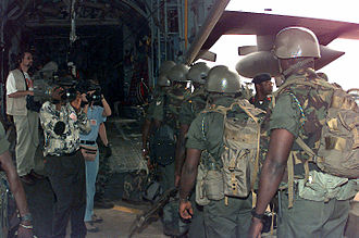 Ghana Armed Forces - Ghana Army soldiers boarding a C-130 Hercules at Kotoka International Airport to take part in an Economic Community of West African States Monitoring Group mission in Liberia.