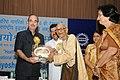 Ghulam Nabi Azad presenting the Vayoshrestha Samman, 2011 for Creative Art to Shri C.S.N. Patnaik, Vishakhapatnam, on the occasion of the 'International Day of Older Persons'.jpg