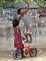 Girl with Boy Reaching for Fruit, Jaffna.jpg