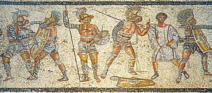 Gladiator - Part of the Zliten mosaic from Libya (Leptis Magna), about 2nd century AD. It shows (left to right) a thraex fighting a murmillo, a hoplomachus standing with another murmillo (who is signaling his defeat to the referee), and one of a matched pair.