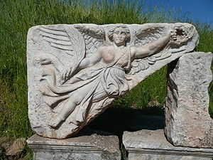 English: A stone carving of the Goddess Nike a...