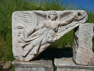 Nike (mythology) - Stone carving of the goddess Nike at the ruins of the ancient city of Ephesus
