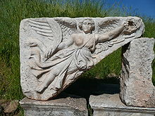 Stone carving of the goddess Nike at the ruins of the ancient Greek city of Ephesus