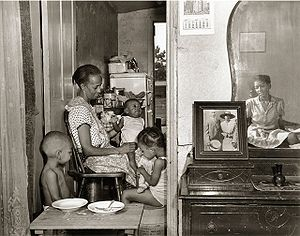 Gordon Parks - A later photograph in the FSA series by Parks shows Ella Watson and her family