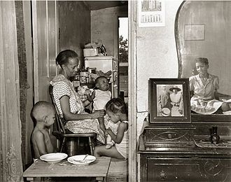 Gordon Parks - A later photograph in the FSA series, by Parks, shows Ella Watson and her family