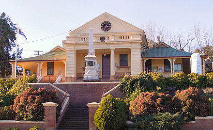 Court House, completed in 1859, was one of the first stone buildings to be erected after the floods of 1852. The interior was originally of red cedar but was destroyed by a fire in 1943 and it was rebuilt with mountain ash. The monument in front of the building is a Boer War memorial. Gundagai courthouse.jpg