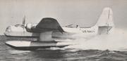 A seaplane kicks up an impressive plume of spray during takeoff.