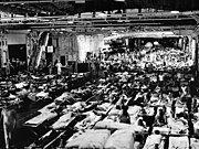 Hangar of USS Enterprise (CV-6) during a Magic Carpet voyage, in September 1945 (80-G-495657)
