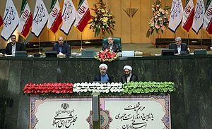 First inauguration of Hassan Rouhani - Hassan Rouhani taking oath of office in the Parliament building, Chief Justice Sadeq Larijani in his left