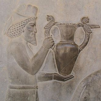 Wine - Detail of a relief of the eastern stairs of the Apadana, Persepolis, depicting Armenians bringing an amphora, probably of wine, to the king.