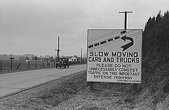 United States Numbered Highway System - This sign, photographed in 1941 on US 99 between Seattle, Washington, and Portland, Oregon, illustrates one rationale for a federal highway system: national defense.