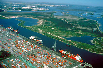 Wharf - The Barbours Cut Terminal of the Port of Houston, USA. This cargo shipping terminal has a single large wharf with multiple berths.