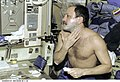ISS Expedition 2 Usachev prepares to shave.jpg