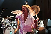 Ian Gillan playing air guitar.jpg