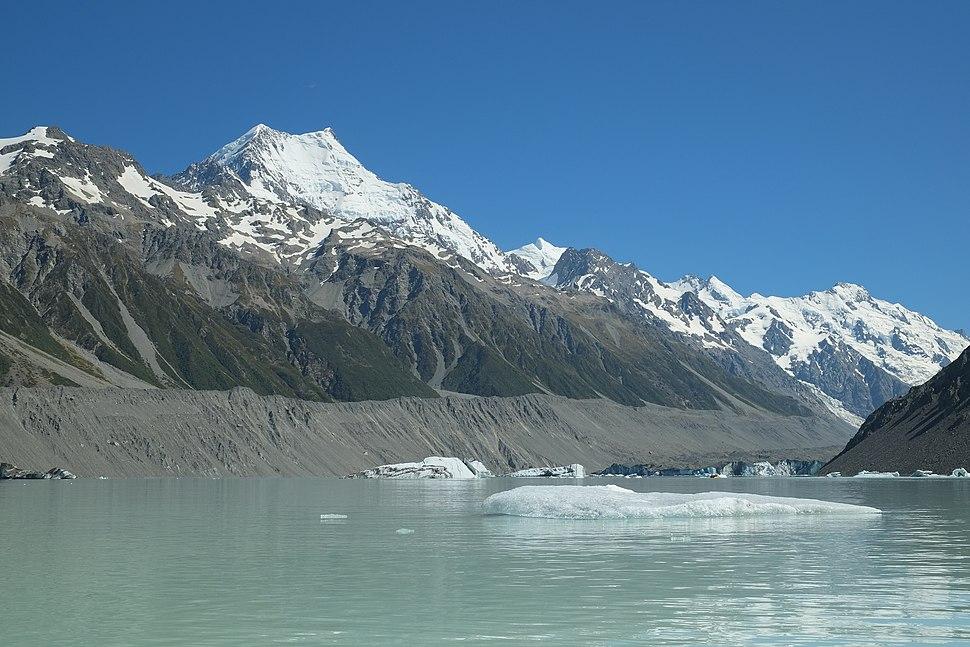 Icebergs floating in Tasman Glacier Lake, Aoraki Mount Cook in the background