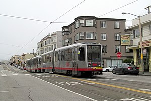 Taraval and 26th Avenue station - Inbound train passing 26th Avenue stop in June 2017
