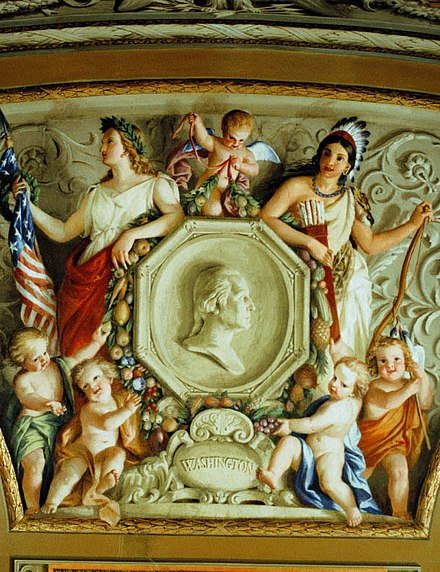 Detail from a 1855-56 fresco by Constantino Brumidi in the U.S. Capitol in Washington, D.C., showing two early symbols of America: Columbia (left) and the Indian princess Indian princess and Columbia.jpg