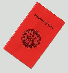 A small red cardstock booklet bearing the text,