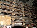 Inside the Salt Mine of Wieliczka, Logs Supporting a Cavern - panoramio.jpg