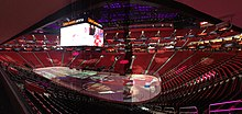 Interior of little Caesars arena panorama.jpg
