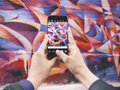 Iphone taking picture of graffiti (Unsplash).png