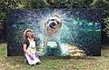 """Iris Scott in front of her oil finger painting """"Jake the Giant"""".jpg"""