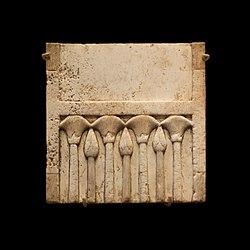 Plaque fragment: alterning papyrus flowers