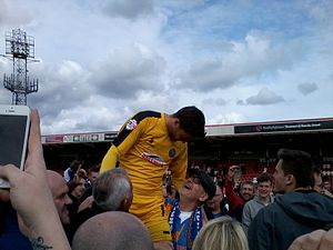 Jayson Leutwiler - Jayson Leutwiler celebrates on the pitch with Shrewsbury Town supporters, after winning promotion to League One in April 2015.