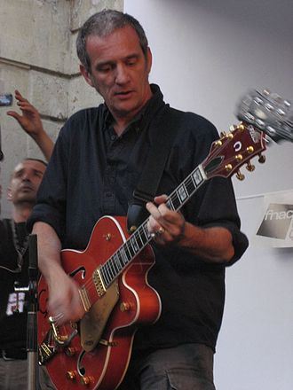 Jean-Paul Roy - Jean-Paul Roy playing guitar with Les Hyènes in 2007