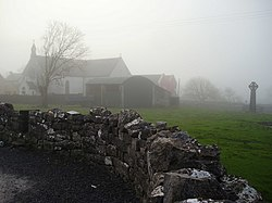 "St. Fachtna's Catholic church and the ""West Cross"" in the mist"