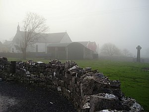 "Kilfenora - St. Fachtna's Catholic church and the ""West Cross"" in the mist"